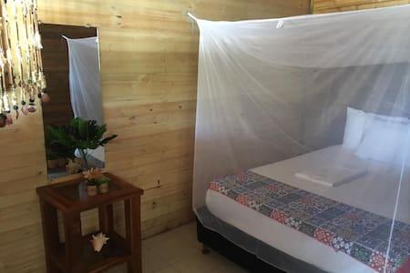 Habitación privada en ISLA ROOTS