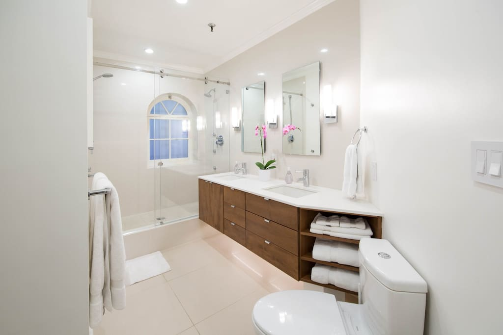 Bathroom has heated floors and dual shower heads and jets