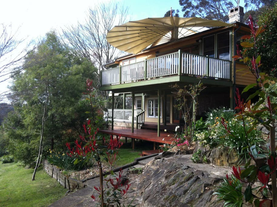 Large sunny north facing decks with sea-shell awning overlooking the large lush grounds