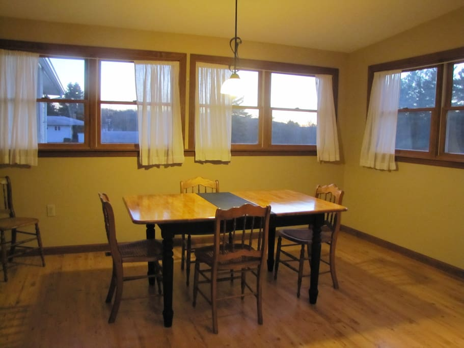 Eat in kitchen with view of private, wooded back yard, additional dining room (not pictured)