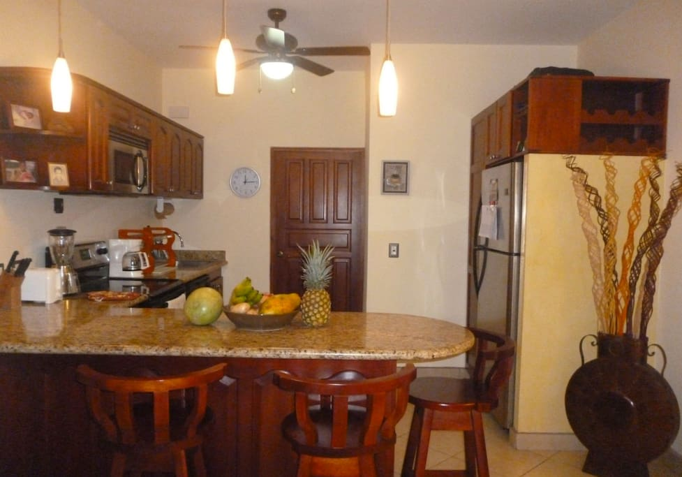 Full sized kitchen with breakfast bar