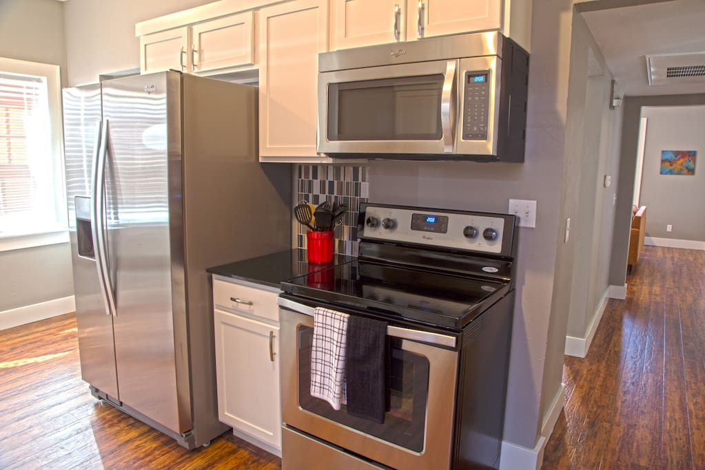 All new stainless steel appliances in the stocked kitchen.