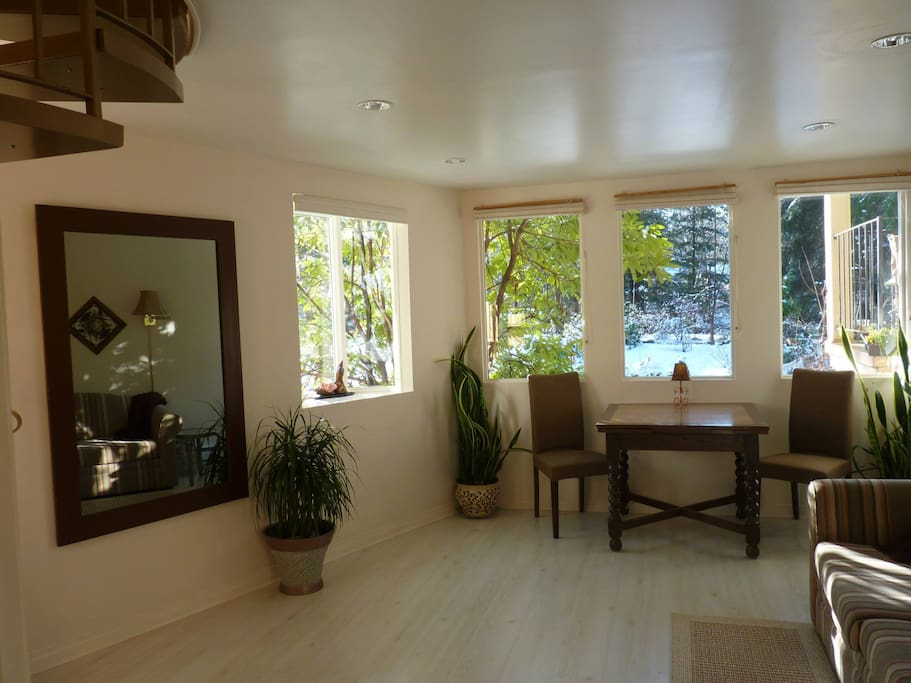 Entry level suite: Living/ dining room ~ sofa bed, TV, Fridge, private dining. Beautiful view.