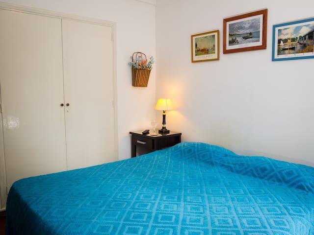 Wooden parquet floor in the bedroom. Closet space.