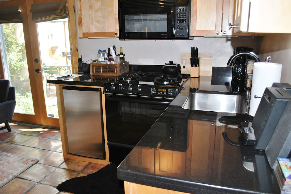 Kitchen with full stove/oven, microwave, dishwasher and undercounter frige. Beautiful granite!