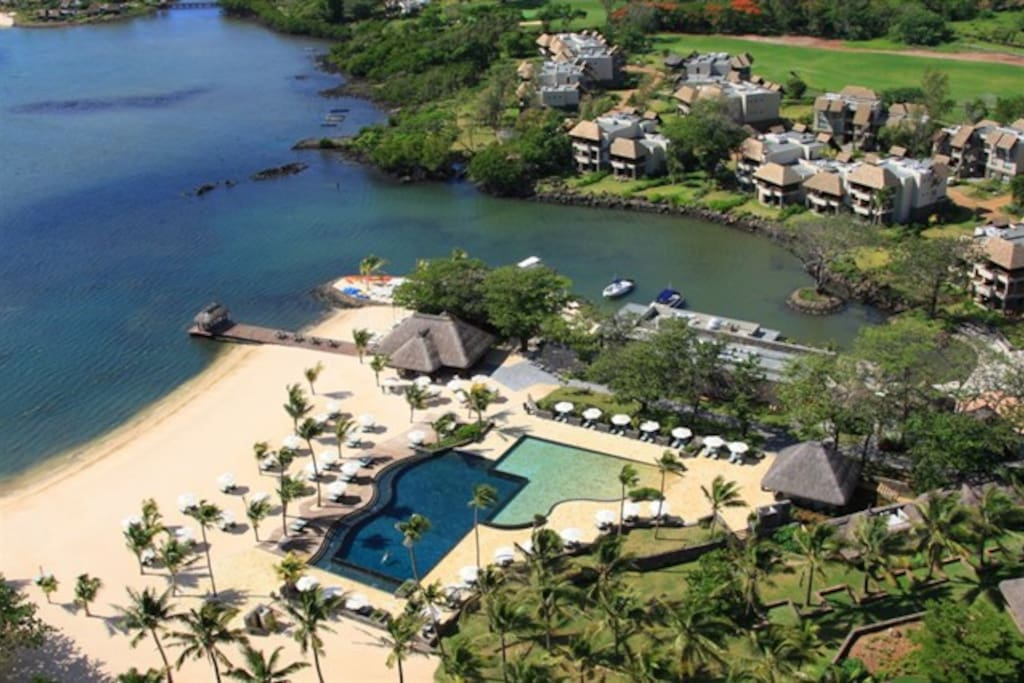 Aerial view of he beach club. Our residence is at the top right of the screen with golf and sea views