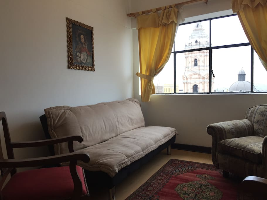 Comfortable living room with unbeatable view of the belfry of the Santo Domingo Church.