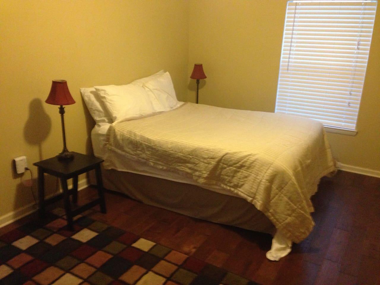Comfy queen bed in bedroom