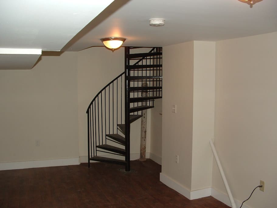 Spiral staircase to lower level bedroom