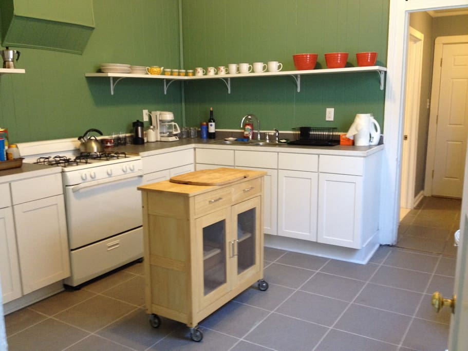 The spacious kitchen has dishes, silverware, coffee, coffee maker and other accoutrements for your stay.