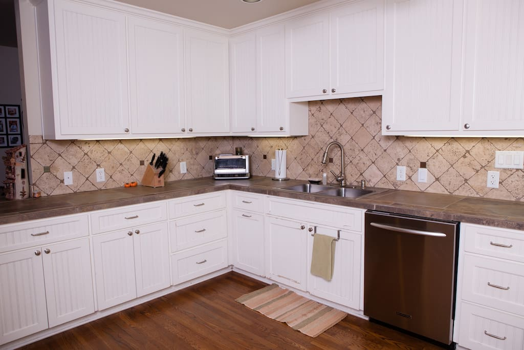 Spacious and functional kitchen full of cookware is a chef's delight.