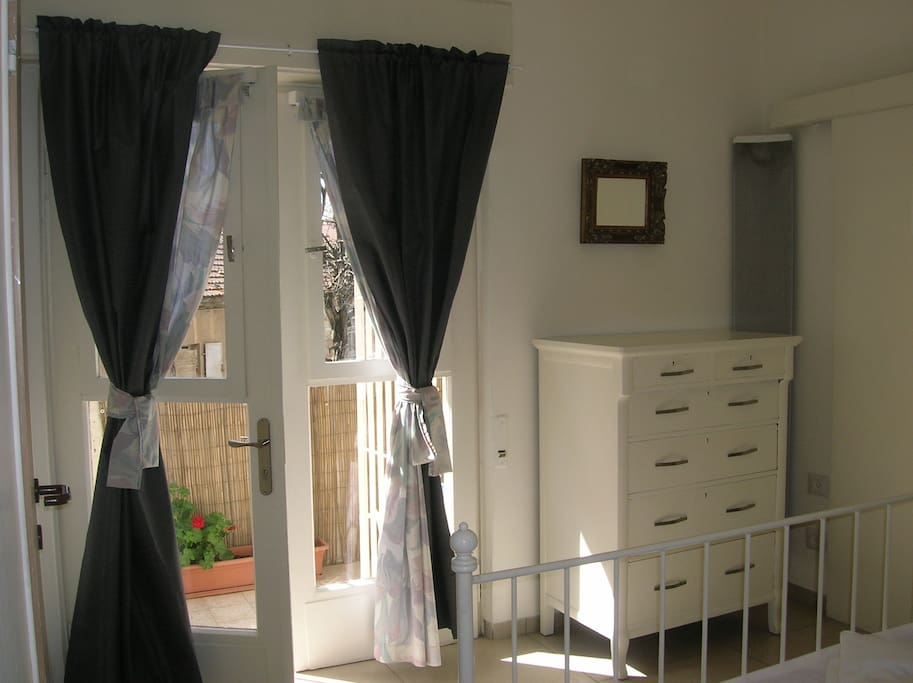 French doors to balcony from bedroom. Black out curtains ensure you sleep well!