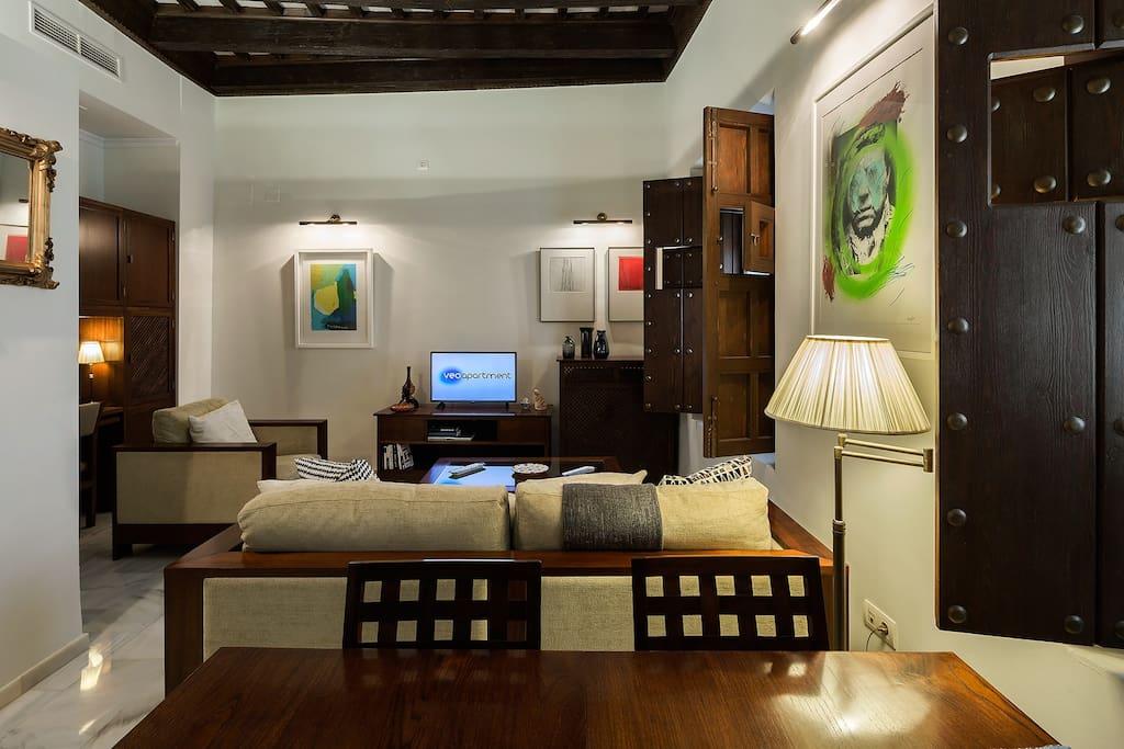 The living space has 2 windows overlooking Fabié street.