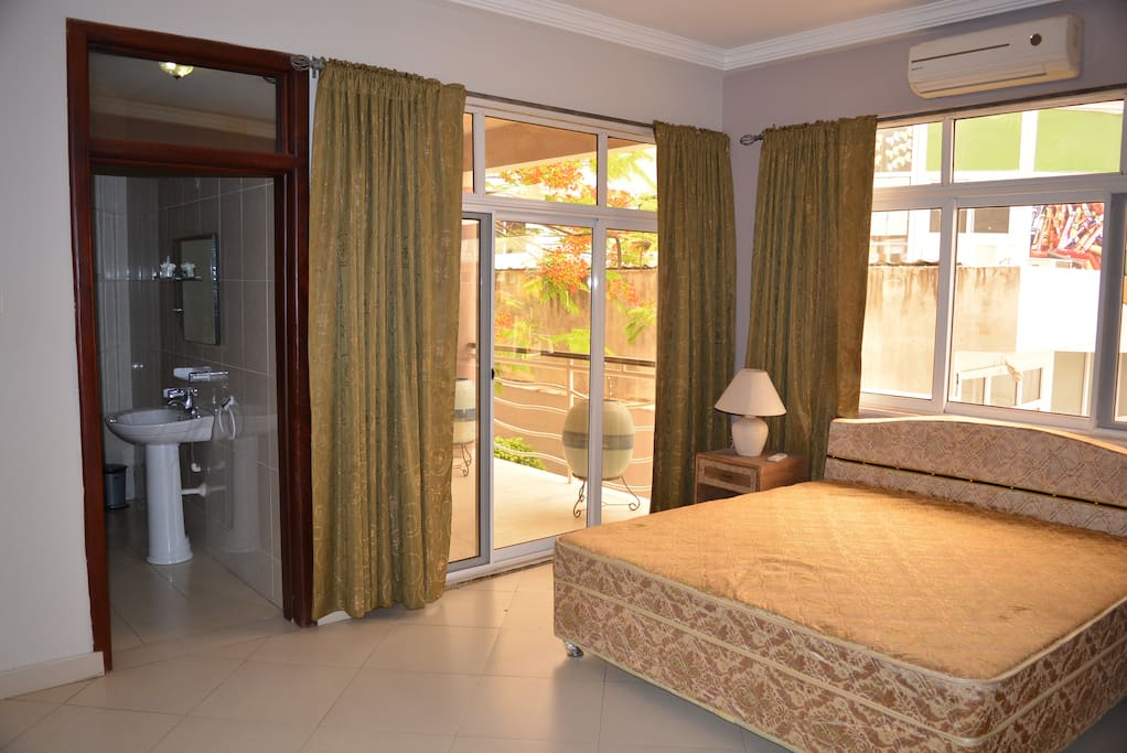 Your bedroom is full of light, with balcony overlooking garden and poolside.