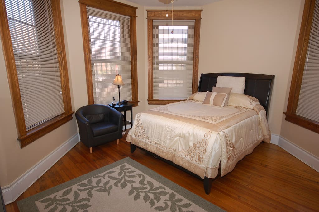 This bedroom is furnished with a queen sized bed. A second TV with cable is also located in this bedroom