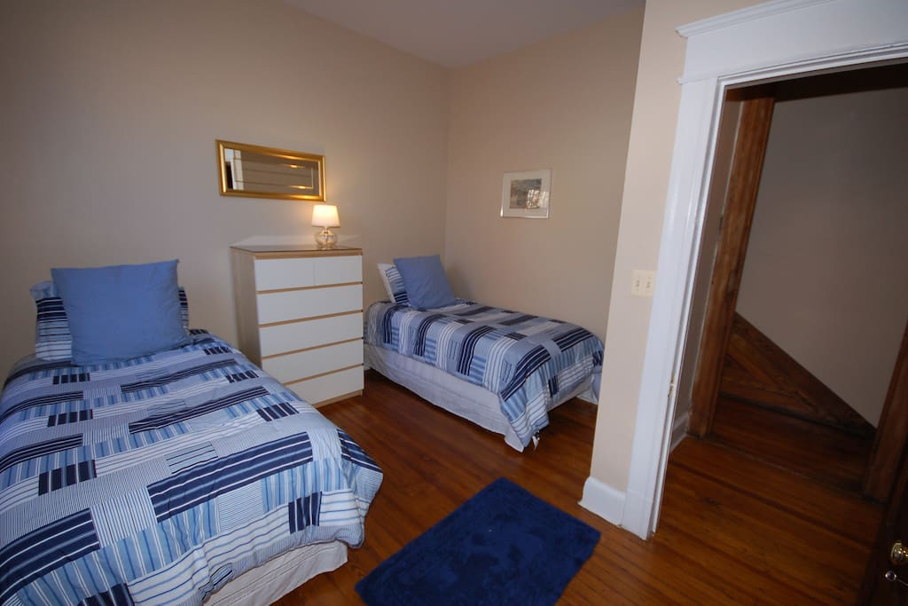 This bedroom is furnished with 2 twin sized beds