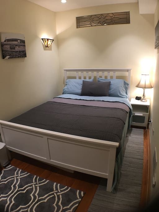 Sealy Posturepedic memory foam queen mattress in cozy room with large closet, and leaded-glass accent windows.