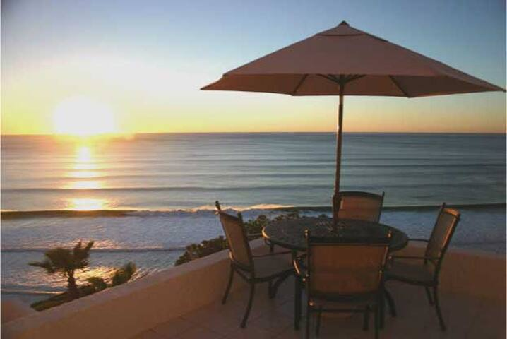 Our dining deck at sunset is also just off the master bedroom.