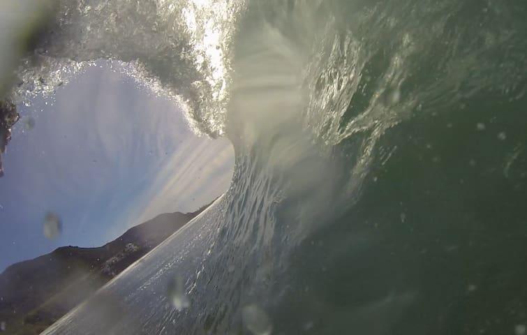 Gopro surfing barrel shot on the beach below our villa.