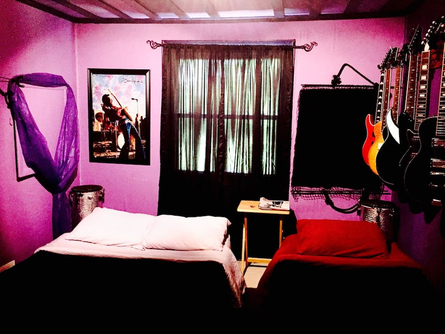 """The """"Purple Haze"""" room, designed as a tribute to the late great Jimi Hendrix. This room also doubles as a creative writer's room, or acoustic rehearsal room. Luxury air-mattress here for two. If you need to accommodate 2 more, we would set up another luxury queen or 2 single air-mattresses to handle it. It's comfy!"""