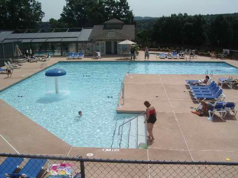 Outdoor pool, indoor pool in back, hot tub upper right and clubhouse (not in picture but to right of pool)