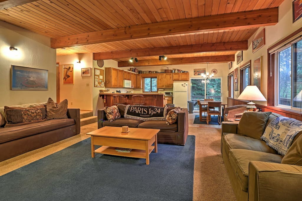 Wood-paneled ceilings, cozy furnishings and mountain-themed decor fill the home's 2,000 square feet of living space.