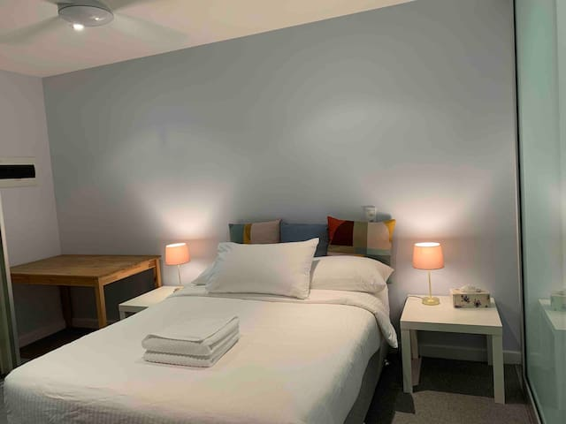 Internal 2nd bedroom with double bed, built in wardrobe, mirror and built in desk.