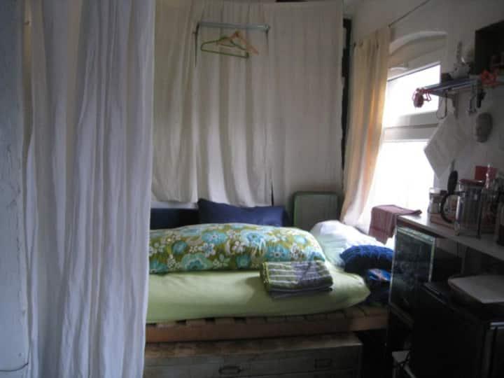 Bed in artist studio