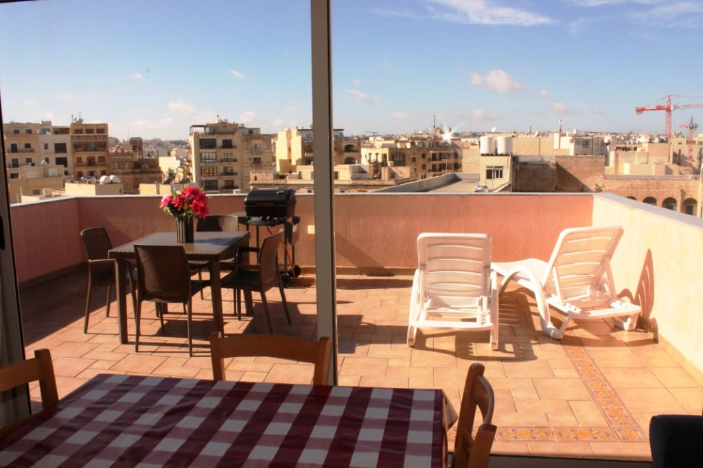 Large and Sunny outside terrace with bbq and garden furniture