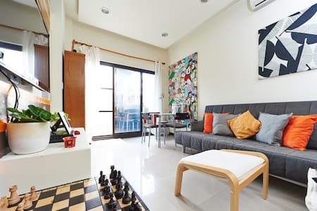 "A room for two people in a safe, clean and very comfortable apartment. A short walk from Zhuwei MRT station. Our modern home offers rest & relaxation with easy access to ""traditional"" Taipei. The design is contemporary, functional & offers modern amenities. Also near Danshui & Beitou tourist destinations."