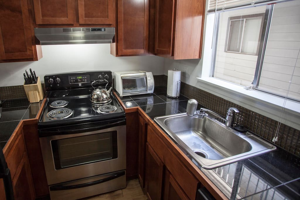 Aside from microwave, kitchen has everything you'd need. Coffee maker, stove, oven, fridge, toaster oven.