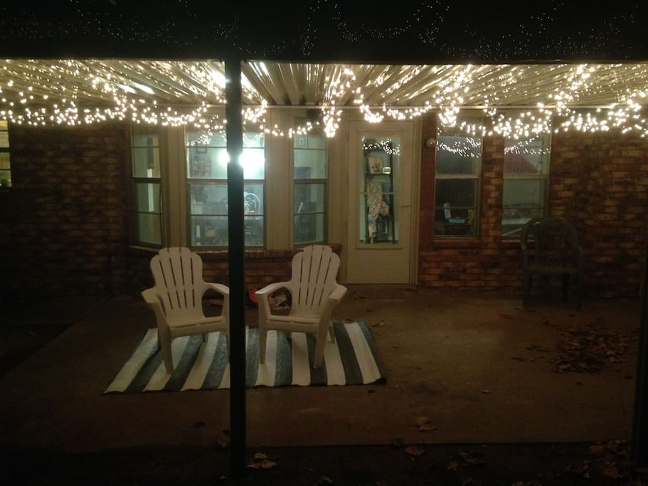 This is the back patio at night, perfect for relaxing after a long day.