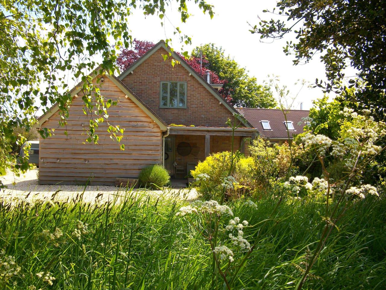 The cottage entrance & parking space