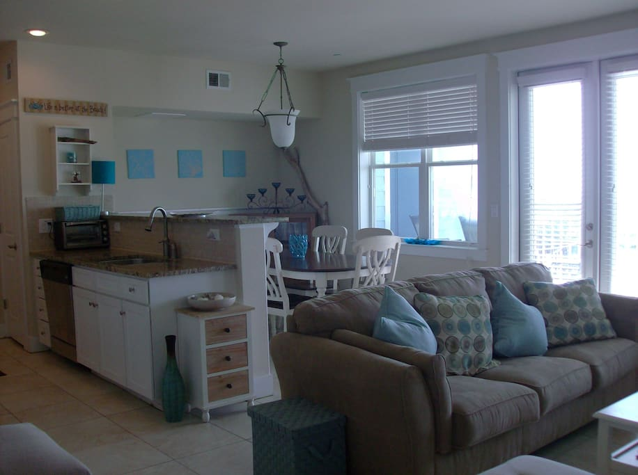 Spacious living area with a wall of gulf views. Porcelain tile floors throughout.