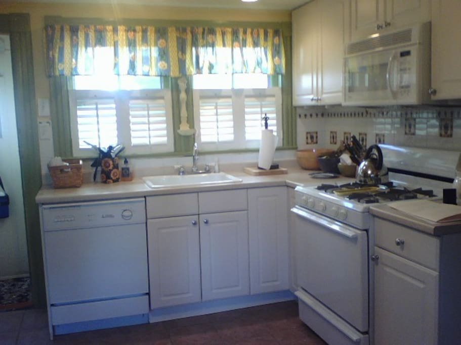 Kitchen equipped with dishwasher, microwave, dishes, glassware, pots and pans!!