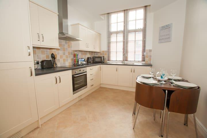 Fully equipped kitchen including dining area, washing machine and fridge freezer.
