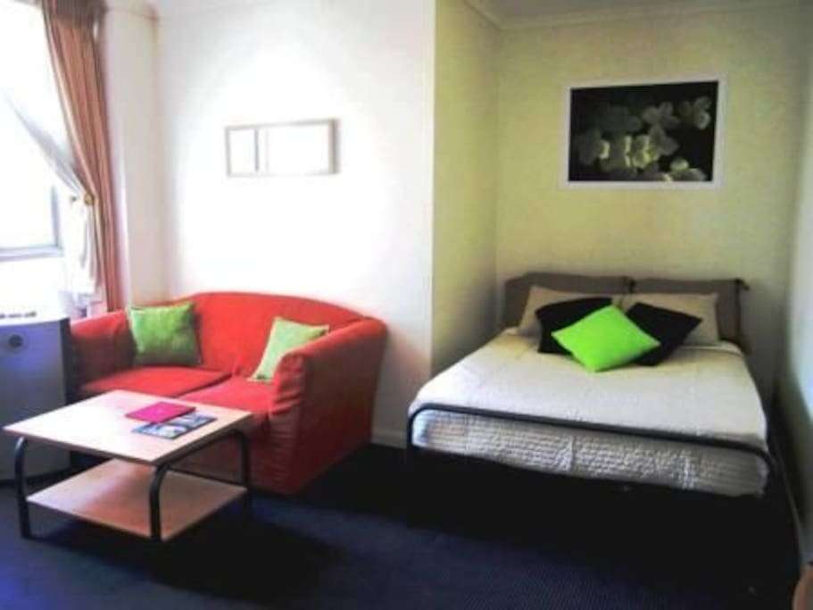 Double bed and couch (couch is now on the other side of the room)