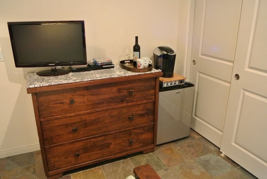 Flat screen TV, Blu-ray, Keurig with a selection of coffee and tea, mini-fridge, and a bottle of wine with every stay.