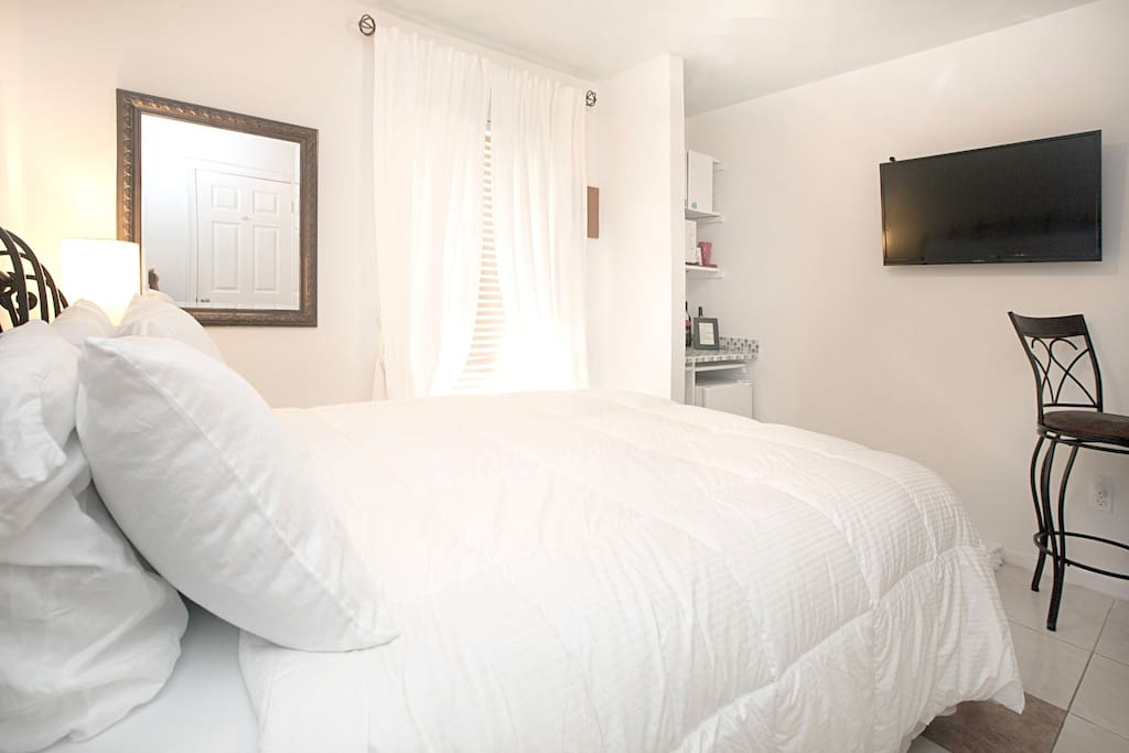 Your room with pillow top Queen sized bed.