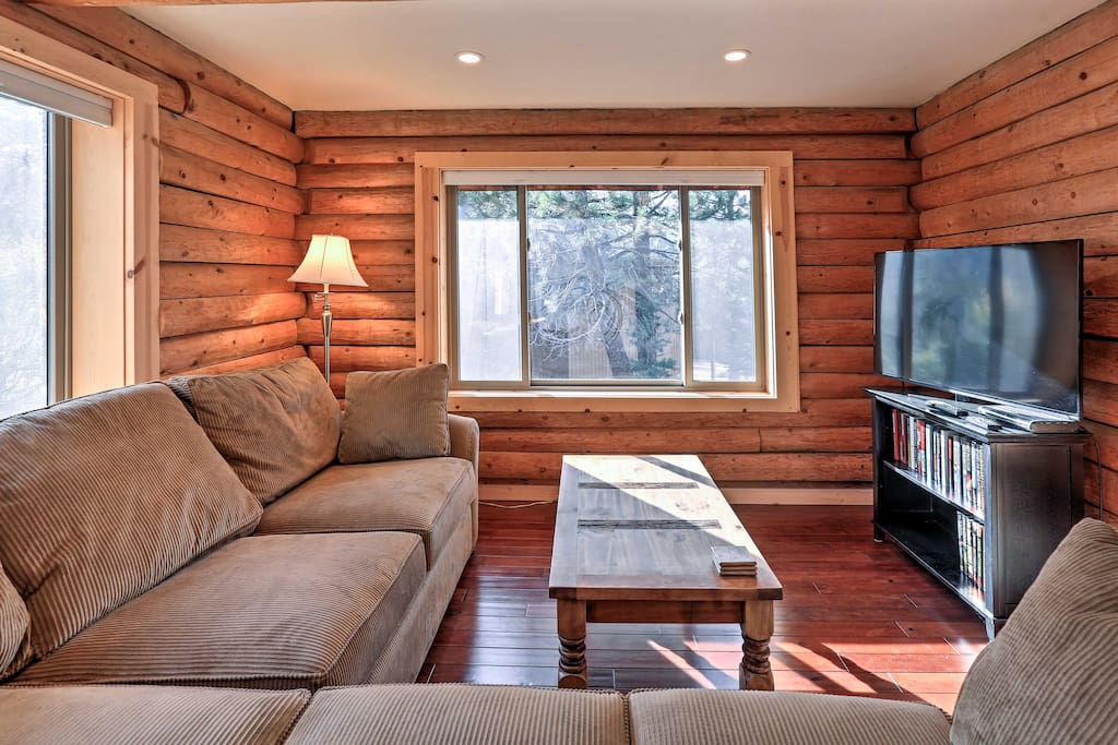 Relax on the L-shaped couch and watch shows on the flat-screen cable TV.