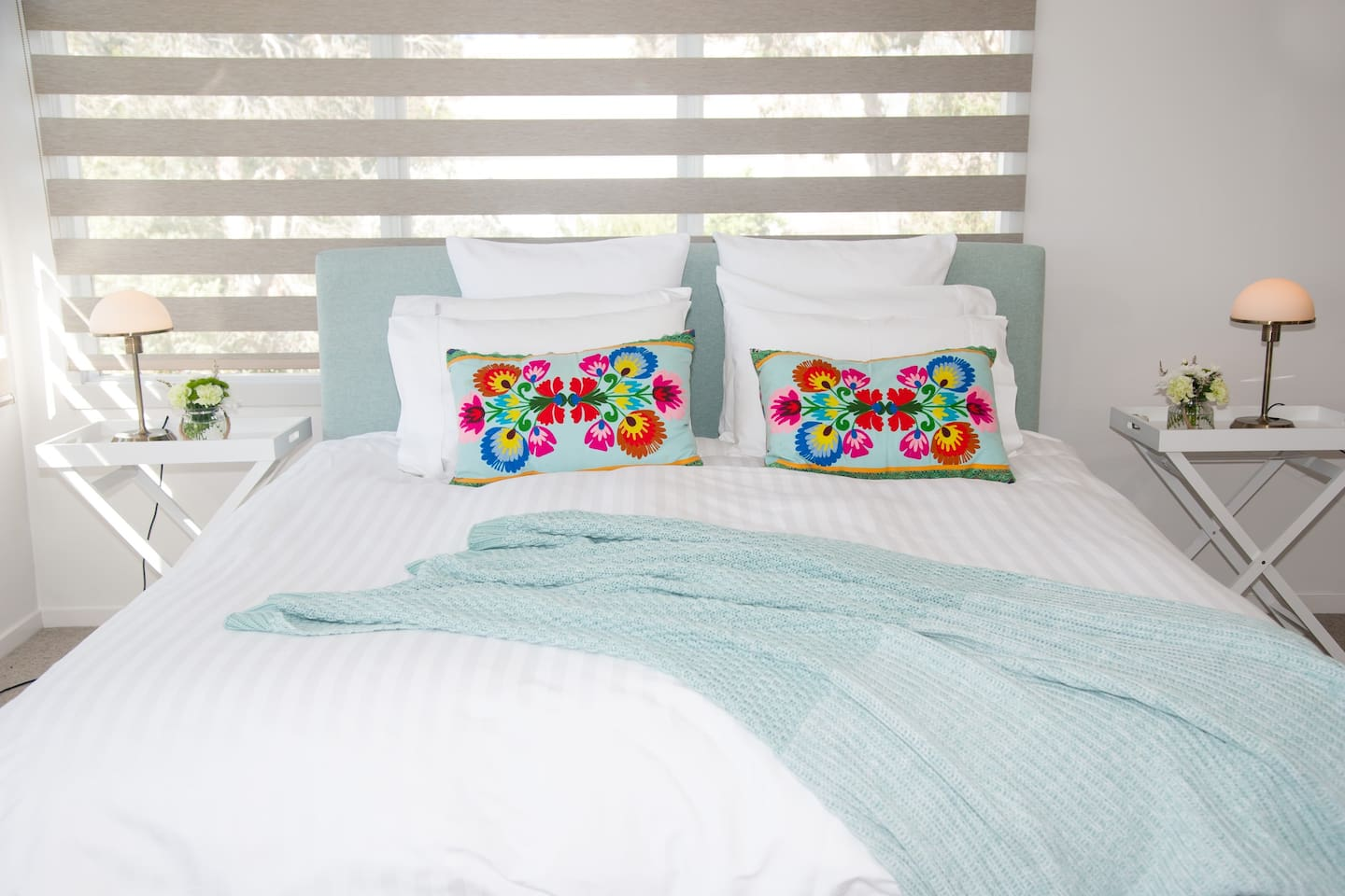 King bed with crispy clean quality linen. Spacious bedroom also has lounge chairs to relax in and enjoy the views across Milton.