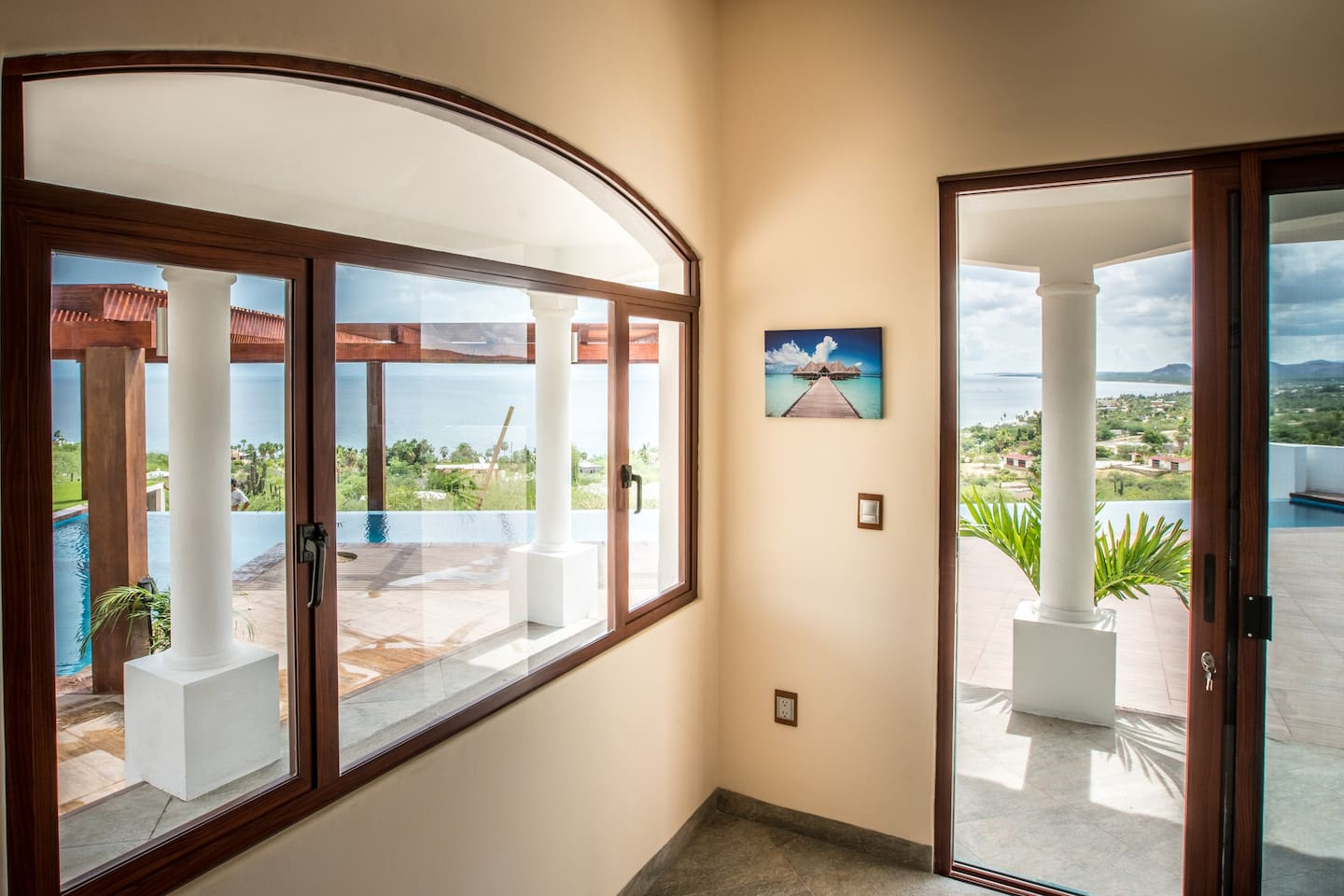 Room #1 has 2 views, the large window provide an incredible view over the sea and Kids' pool area.