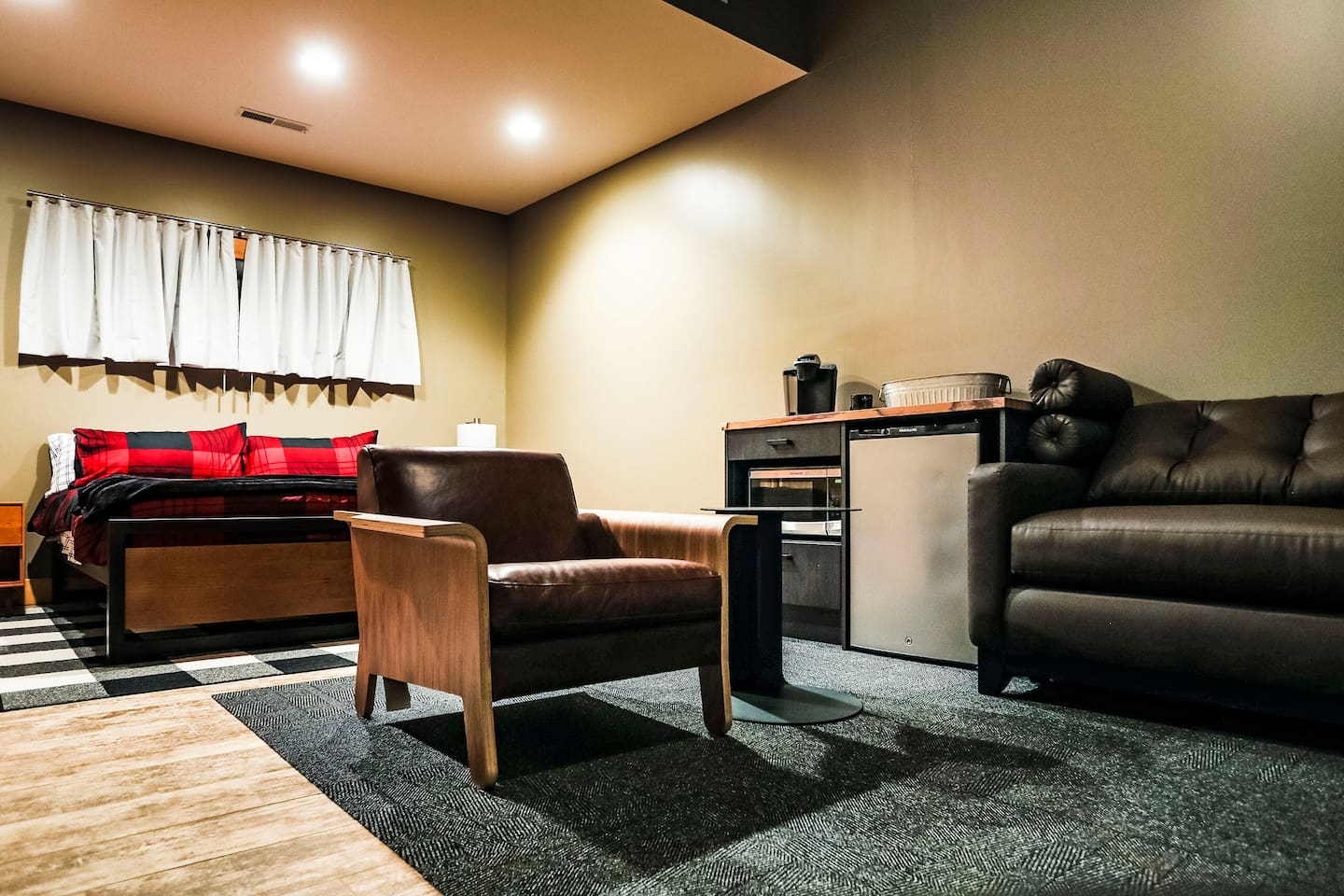 Modern Single Cabin King Room with Pullout Couch, Refridgerator, Microwave, Keurig, and Walk-in Closet