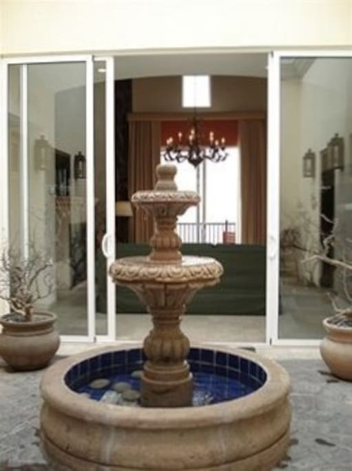 Enter your private Courtyard greeted by a fountain