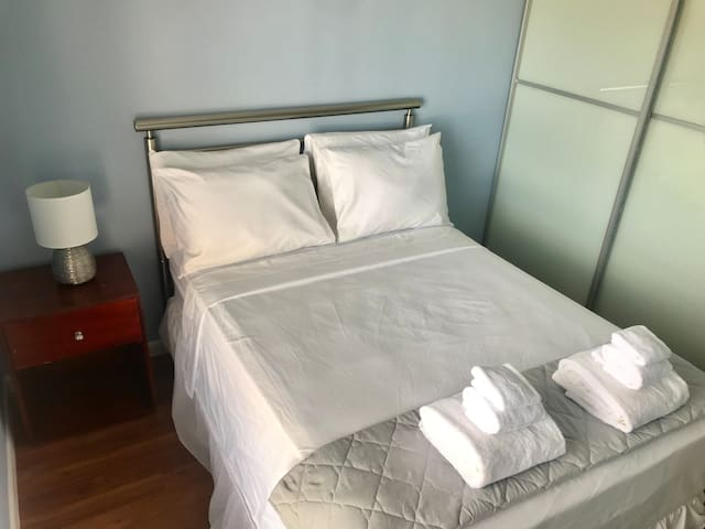 Bedroom 2: Double occupancy full size bed with towels