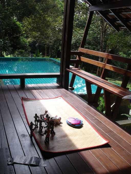 Verandah facing the swimming pool and on the other side, the Langat River.