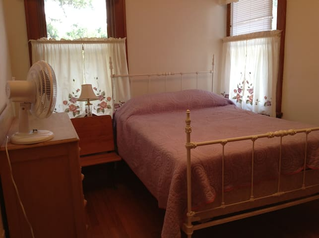 Full bed with sleeping porch attached.