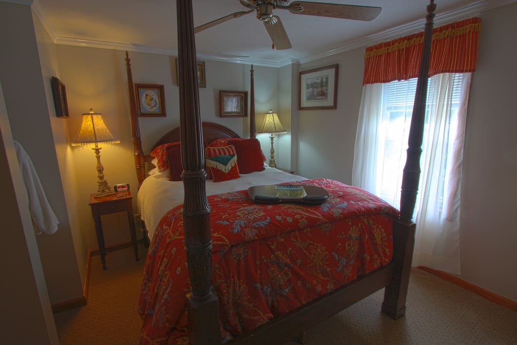 Queen-sized four-poster bed in master bedroom