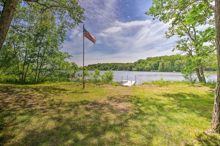 The 4-bedroom, 3-bathroom vacation rental sits on the shores of Spooner Lake.