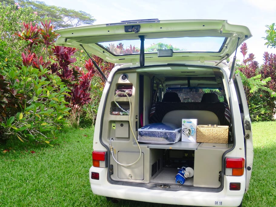 Shower head in the back great for cooling down, fresh water rinse, keeping sand off of you and out of the van ;-)